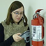 inspecting a fire extinguisher